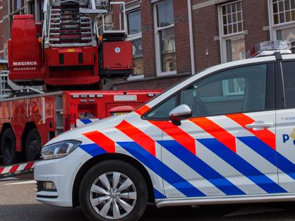 ladderwagen met politieauto